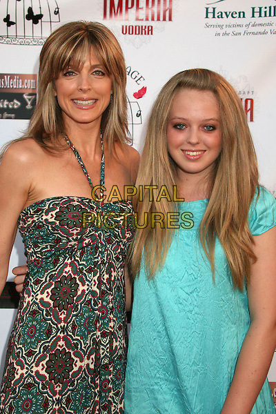 "MARLA MAPLES & TIFFANY TRUMP.""Hats Off For Cancer"" Benefit Party at Sugar Boutique, Hollywood, California, USA..May 9th, 2007.half length green pattern halterneck dress turquoise black purse bag oversized big baseball cap hat .CAP/ADM/BP.©Byron Purvis/AdMedia/Capital Pictures"