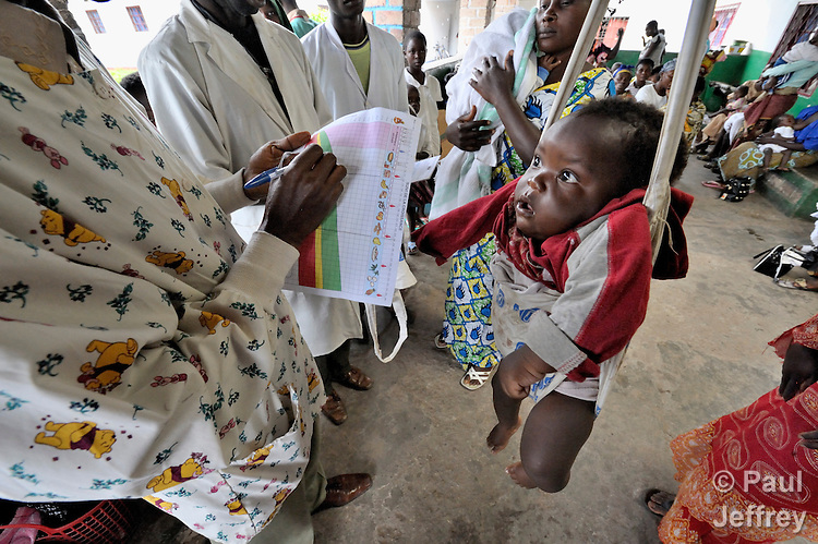 A child is weighed and measured as part of a wellness program at the Shungu Memorial Health Center in Kamina, Democratic Republic of the Congo. The center is funded by the United Methodist Church.