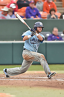 Main Black Bears catcher Kevin Stypulkowski (33) swings at a pitch during a game against the Clemson Tigers at Doug Kingsmore Stadium on February 20, 2016 in Clemson, South Carolina. The Tigers defeated the Black Bears 9-4. (Tony Farlow/Four Seam Images)
