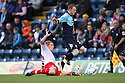 Stuart Beavon of Wycombe is tackled by Mark Roberts of Stevenage. - Wycombe Wanderers v Stevenage - Adams Park, High Wycombe - 31st December 2011  .© Kevin Coleman 2011