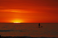 May 15, 2014 - San Diego, California, USA - MICHAEL LESTER paddleboards at La Jolla Shores Beach as smoke from recent  San Diego County wildfires fills the air creating an orange sunset.  (Photo Credit: © K.C. ALFRED/ZUMA PRESS)