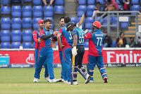 Rashid Khan (Afghanistan) celebrates with Rahmat Shah (Afghanistan) as  a deflated Kusal Perera (Sri Lanka) departs during Afghanistan vs Sri Lanka, ICC World Cup Cricket at Sophia Gardens Cardiff on 4th June 2019