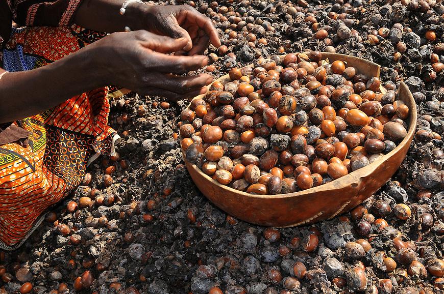 Women processing shea nuts in to shea butter