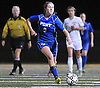 Port Washington No. 9 Caroline McCarthy moves the ball downfield during the Nassau County varsity girls' soccer Class A final against Massapequa at Cold Spring Harbor High School on Tuesday, November 3, 2015. Massapequa won by a score of 3-2.<br /> <br /> James Escher