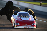 Oct. 27, 2012; Las Vegas, NV, USA: NHRA funny car driver Tommy Johnson Jr during qualifying for the Big O Tires Nationals at The Strip in Las Vegas. Mandatory Credit: Mark J. Rebilas-