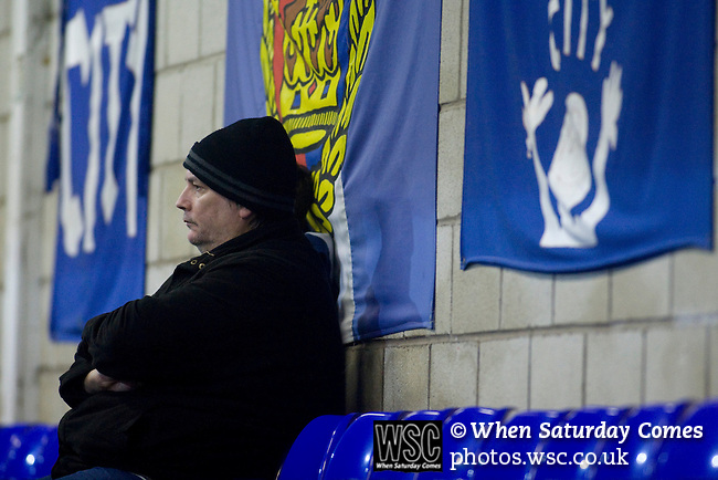 Chester City 1 Altrincham 3, 21/11/2009. Deva Stadium, Football Conference. A home supporter in the West Stand watching the action at the Deva Stadium, Chester, home of Chester City Football Club (in blue), during the club's Blue Square Premier fixture against Cheshire rivals Altrincham. The visitors won by three goals to one. Chester were in administration at the start of the season and were penalised 25 points before the season began. Photo by Colin McPherson.