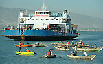 Residents of Port-au-Prince, Haiti, sail aboard a ferry bound for Jeremie in order to escape from the capital city, which was devastated by a January 12 earthquake. As many as 200,000 people may have already left Port-au-Prince, seeking better conditions elsewhere in the Caribbean island nation.