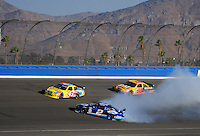 Aug 31, 2008; Fontana, CA, USA; NASCAR Sprint Cup Series driver Kurt Busch (2) spins as Bobby Labonte (43) and Dave Blaney (22) go high to avoid him during the Pepsi 500 at Auto Club Speedway. Mandatory Credit: Mark J. Rebilas-