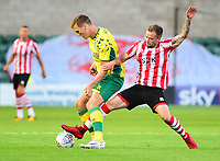 A Lincoln City trialist puts pressure on a Norwich City Sean Raggett<br />