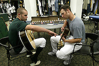 OAKLAND, CA - JUNE 5:  Bobby Crosby and Rich Harden of the Oakland Athletics before the MLB game against the Toronto Blue Jays at Network Associates Coliseum on June 5, 2004 in Oakland, California. The A's defeated the Blue Jays 4-0. (Photo by Michael Zagaris/MLB Photos via Getty Images)