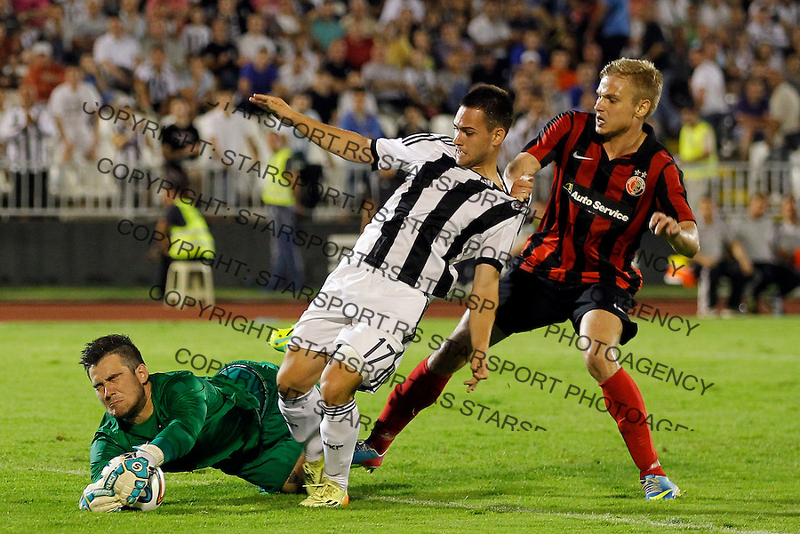 Fudbal Football Soccer<br /> UEFA Champions league-2nd qualifying round<br /> Partizan v HB Torshavn (Faroe Islands)<br /> Andrija Zivkovic (C) and goalkeeper Teitur Gestson (L)<br /> Beograd, 07.15.2014.<br /> foto: Srdjan Stevanovic/Starsportphoto &copy;