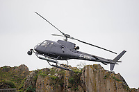 Tuesday  28 June 2016<br /> Pictured: Cast members act out a scene  with guns on the island while a helicopter takes aerial shots <br /> Re: Sherlock filming on St.Catherines Island, Wales, UK