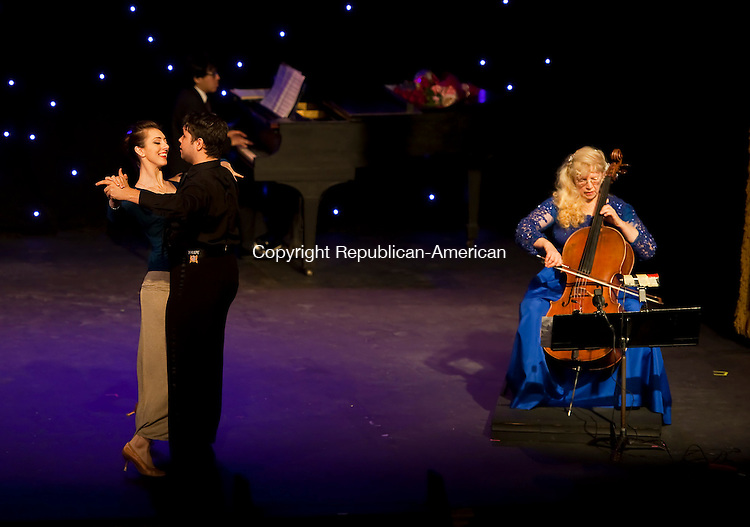 THOMASTON,  CT-122114JS02- Concert cellist Thirzah Bendokas, right, plays as ballroom dancers dance during a special &quot;Cello-bration&quot; holiday concert Sunday at the Thomaston Opera House. <br />  Jim Shannon Republican-American