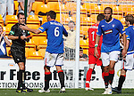Referee Dougie McDonald red cards Madjid Bougherra after continual complaints and dissent from the Rangers defender