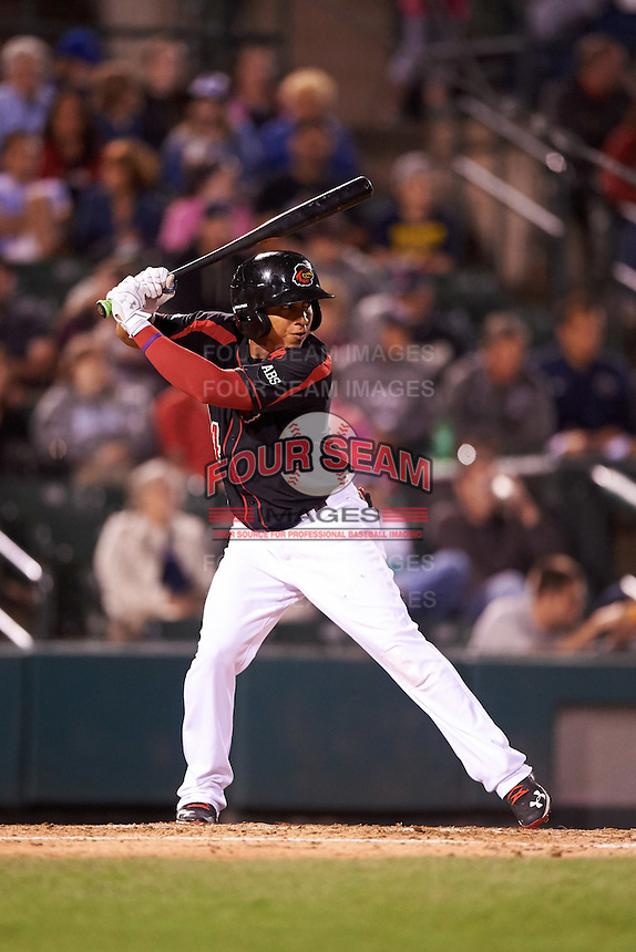 Rochester Red Wings shortstop Wilfredo Tovar (4) at bat during a game against the Syracuse Chiefs on July 1, 2016 at Frontier Field in Rochester, New York.  Rochester defeated Syracuse 5-3.  (Mike Janes/Four Seam Images)