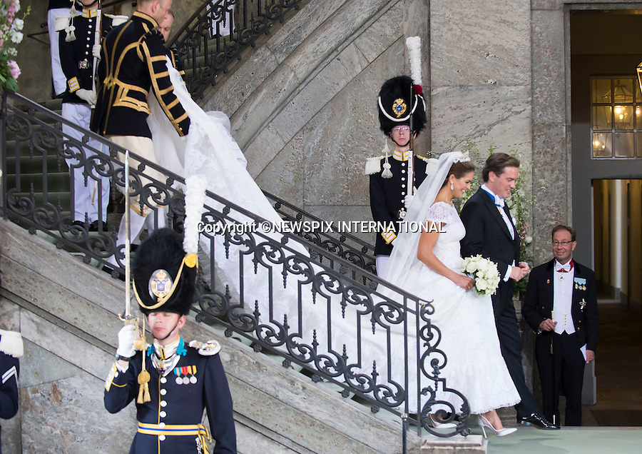 PRINCESS MADELEINE AND CHRISTOPHER O'NEILL WEDDING<br /> The Bridal Couple leave the Royal Chapel, Royal Palace, Stockholm, Sweden_08/06/2013<br /> Mandatory Credit Photo: &copy;Alex Dias/NEWSPIX INTERNATIONAL<br /> <br /> **ALL FEES PAYABLE TO: &quot;NEWSPIX INTERNATIONAL&quot;**<br /> <br /> IMMEDIATE CONFIRMATION OF USAGE REQUIRED:<br /> Newspix International, 31 Chinnery Hill, Bishop's Stortford, ENGLAND CM23 3PS<br /> Tel:+441279 324672  ; Fax: +441279656877<br /> Mobile:  07775681153<br /> e-mail: info@newspixinternational.co.uk