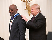 United States President Donald J. Trump awards the Presidential Medal of Freedom to former Minnesota Vikings defensive lineman Judge Alan Page during a ceremony in the East Room of the White House in Washington, DC on Friday, November 16, 2018.  The award is the nation's highest civilian honor and is awarded by the President to individuals who made meritorious contributions to the United States.<br /> Credit: Ron Sachs / CNP<br /> (RESTRICTION: NO New York or New Jersey Newspapers or newspapers within a 75 mile radius of New York City)