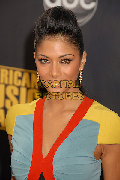 NICOLE SCHERZINGER.2007 American Music Awards at the Nokia Theatre LA Live, Los Angeles, California, USA..November 18th, 2007.headshot portrait black red yellow blue colour block Sherzinger gold earrings .CAP/ADM/BP.©Byron Purvis/AdMedia/Capital Pictures.