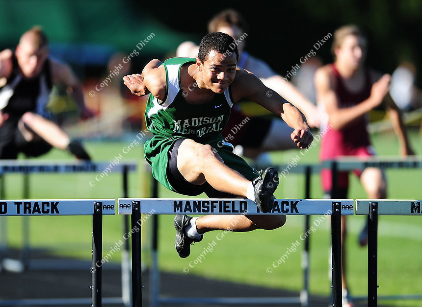 Madison Memorial's Lechein Neblett wins the 110 meter hurdle at the WIAA D1 sectional track and field meet on 5/27/10 at Mansfield Stadium in Madison, Wisconsin