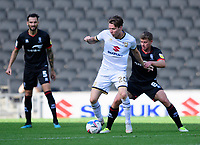 Milton Keynes Dons' Joe Mason shields the ball from Lincoln City's James Jones<br /> <br /> Photographer Chris Vaughan/CameraSport<br /> <br /> The EFL Sky Bet League One - Milton Keynes Dons v Lincoln City - Saturday 19th September 2020 - Stadium MK - Milton Keynes<br /> <br /> World Copyright © 2020 CameraSport. All rights reserved. 43 Linden Ave. Countesthorpe. Leicester. England. LE8 5PG - Tel: +44 (0) 116 277 4147 - admin@camerasport.com - www.camerasport.com