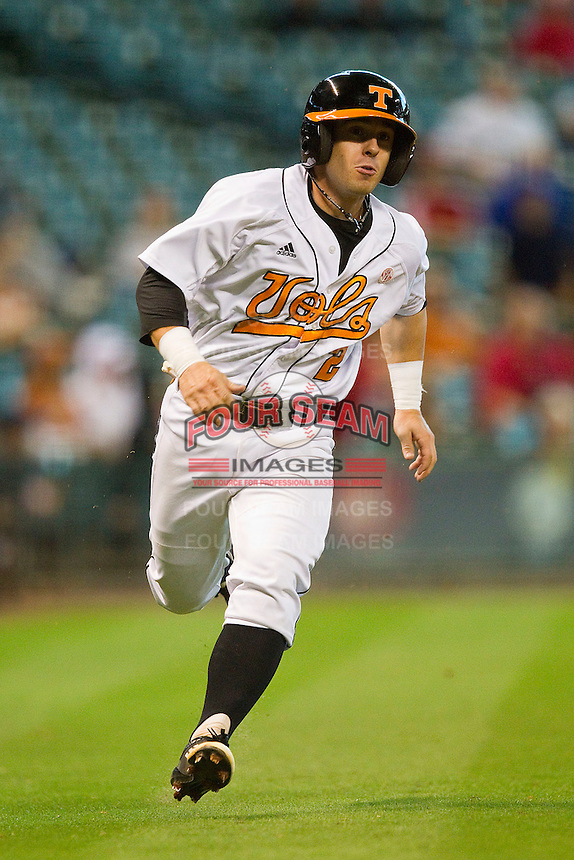 Zach Osborne #2 of the Tennessee Volunteers scores a run against the Texas Longhorns at Minute Maid Park on March 3, 2012 in Houston, Texas.  The Volunteers defeated the Longhorns 5-4.  Brian Westerholt / Four Seam Images