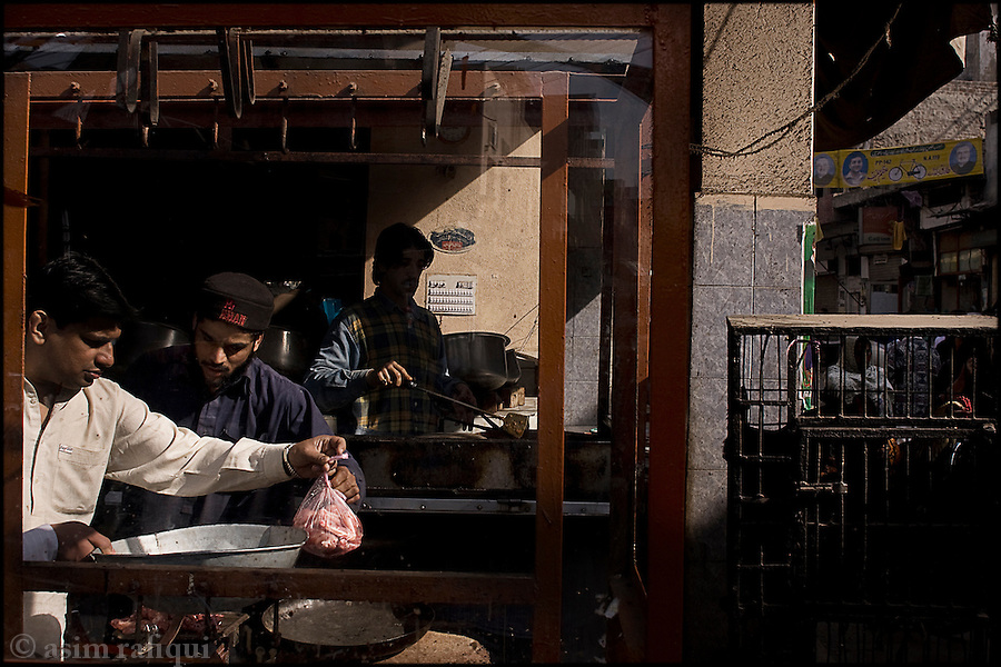 a street side restaurant in the old city of lahore