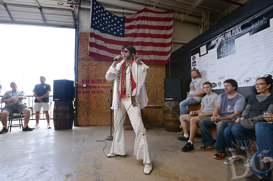 NWA Democrat-Gazette/BEN GOFF @NWABENGOFF<br /> Dusty Duling, an Elvis Presley tribute artist from Eureka Springs who goes by the stage name Delvis, sings a few songs between ping pong games on Sunday Feb. 21, 2016 during the 2nd Annual Ping Pong for Paws tournament at Ozark Beer Co. in Rogers. Proceeds from the tournament go to support the Humane Society for Animals of Rogers.
