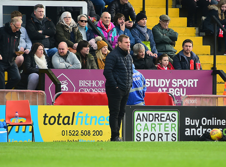 Mansfield Town manager David Flitcroft shouts instructions to his team from the technical area<br /> <br /> Photographer Andrew Vaughan/CameraSport<br /> <br /> The EFL Sky Bet League Two - Lincoln City v Mansfield Town - Saturday 24th November 2018 - Sincil Bank - Lincoln<br /> <br /> World Copyright © 2018 CameraSport. All rights reserved. 43 Linden Ave. Countesthorpe. Leicester. England. LE8 5PG - Tel: +44 (0) 116 277 4147 - admin@camerasport.com - www.camerasport.com