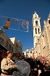 Bethlehem, Syrian Orthodox Christmas Procession, Church of St Mary in the background&#xA;<br />