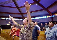 STAFF PHOTO BEN GOFF  @NWABenGoff -- 10/26/14 Elizabeth Lopez sings along during the Spanish language service at the First Baptist Church of Rogers Olive Street campus on Sunday October 26, 2014. The church has reopened its old downtown location and now offers an English language service at 9:00a.m. as well as the Spanish service at 11:30a.m. in an effort to  'intentionally pursue and celebrate ethnic diversity,' according to the church's website.