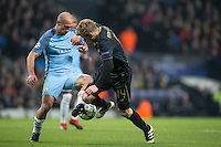 Pablo Zabaleta of Manchester City takes the ball from Stuart Armstrong of Celtic during the UEFA Champions League GROUP match between Manchester City and Celtic at the Etihad Stadium, Manchester, England on 6 December 2016. Photo by Andy Rowland.