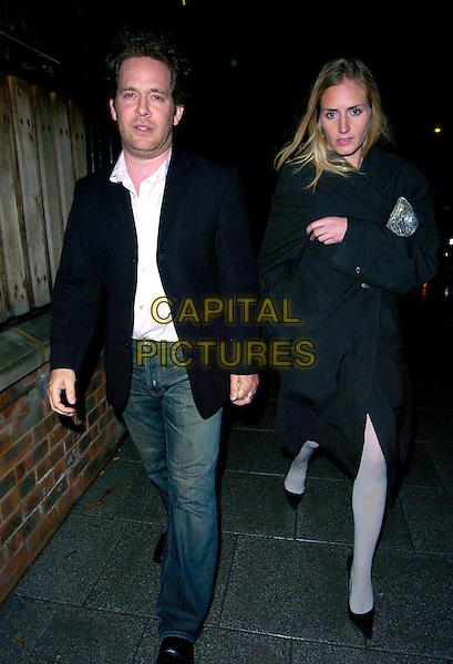 TOM HOLLANDER & GUEST.Vernon God Little - gala performance, The Young Vic theatre, London, England..May 10th, 2007 .full length jeans denim black coat blues suit jacket holding hands .CAP/CAN.©Can Nguyen/Capital Pictures