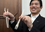 """March 9 2017, Tokyo, Japan - Jun Takagi, London based product designer displays a wooden fork which can transform to a pair of chopsticks """"Split Fork & Chopsticks"""" at a presentation of All Nippon Airways (ANA) crowdfunding """"WonderFLY"""" in Tokyo on Thursday, March 9, 2017. ANA launched crowdfunding platform from last year and they announced award winning unique products.    (Photo by Yoshio Tsunoda/AFLO) LwX -ytd-"""