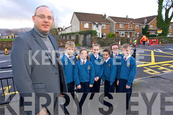 Kieran O'Toole (principal) pictured with students Joey Nagle, Ciara O'Mahony, Aisling O'Leary, Vanessa Covaci, Lauren Dowling, Conor O'Brien and pictured outside Scoil Eoin, Balloonagh Primary school on Wednesday morning as they have new safety bollards at the entrance of the school.