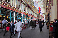 London midday vibration with pedestrians of the City of London running through a gallery of the covered market Leadenhall Market, London, UK. Leadenhall Market was redesigned in the late 19th century using wrought iron and glass structures by Sir Horace Jones and extensively restored in 1991. Picture by Manuel Cohen