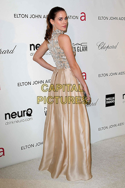 Christa B. Allen.The 21st Annual Elton John AIDS Foundation Academy Awards Viewing Party held at The City of West Hollywood Park in West Hollywood, California, USA..February 24th, 2013.oscars full length dress silk satin skirt beige silver gold sleeveless beads beaded hand on hip looking over shoulder .CAP/ADM/KB.©Kevan Brooks/AdMedia/Capital Pictures.