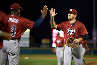 Lehigh Valley IronPigs first baseman Chris McGuiness (24) high fives pitching coach Ray Burris (34) after a game against the Rochester Red Wings on July 4, 2015 at Frontier Field in Rochester, New York.  Lehigh Valley defeated Rochester 4-3.  (Mike Janes/Four Seam Images)