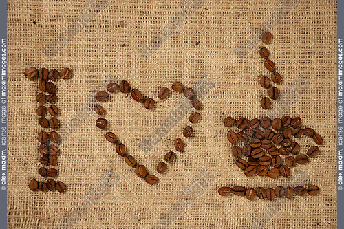 Conceptual artistic pattern I love coffee made from coffee beans on a sacking background