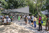 Crowds of burger lovers at the Shake Shack in Madison Square Park in New York on Tuesday, July 7, 2015. Shares of the Shake Shack plunged as a report by Morgan Stanley analysts downgraded the stock as too expensive. (© Richard B. Levine)