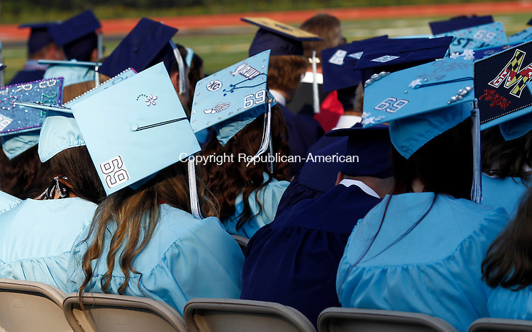 """Oxford, CT- 17 June 2014-061714CM07-  Oxford High School graduates wear the number """"69"""" to pay tribute to classmate Brandon Giordano, who died in 2012, during commencement exercises at Oxford High School on Tuesday. It was a number Girodano wore on his football jersey.    Christopher Massa Republican-American"""