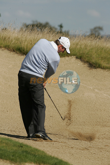Marc Warren takes his 2nd shot from the fairway bunker on the 6th hole during the first round of the Seve Trophy at The Heritage Golf Resort, Killenard,Co.Laois, Ireland 27th September 2007 (Photo by Eoin Clarke/GOLFFILE)