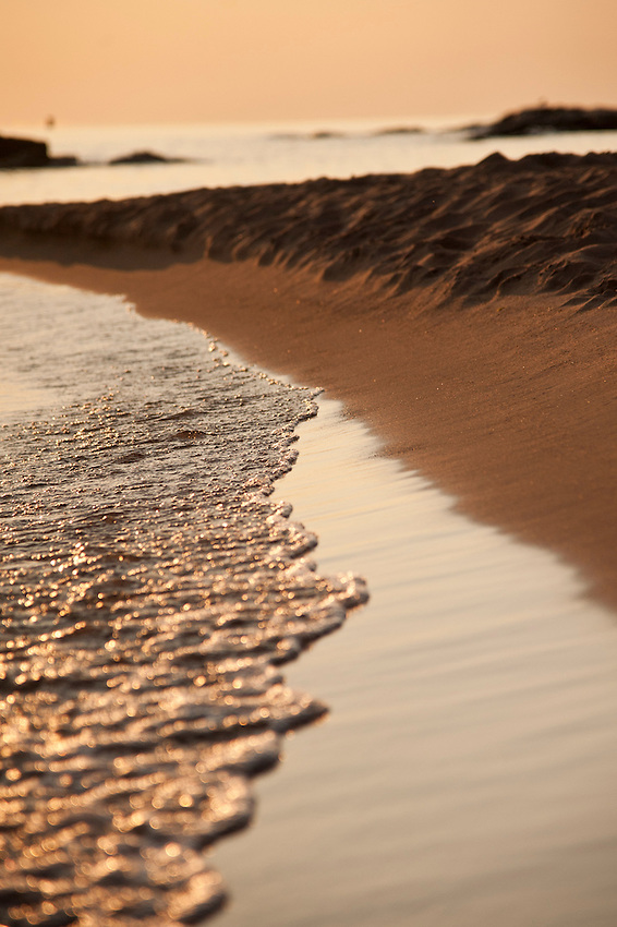 Lake Superior waves and sand at dawn at McCarty Cove a popular swimming beach in Marquette, Michigan.