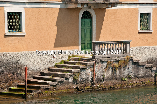 Steps into Lake Como from a house on the water in the town of Sala Comacina, Italy