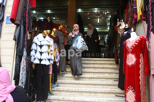 Palestinians shop at a market in Gaza city on 13 November 2010, in preparation for the Muslim holiday of Eid al-Adha or the Feast of Sacrifice, which marks the end of the annual pilgrimage.. Photo by Ashraf Amra