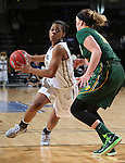 SIOUX FALLS, SD - MARCH 8: Tysia Manuel #13 of Oral Roberts drives past Holly Johnson #12 of North Dakota State in the first half of their first round Summit League Championship Tournament game Sunday afternoon at the Denny Sanford Premier Center in Sioux Falls, SD. (Photo by Dick Carlson/Inertia)