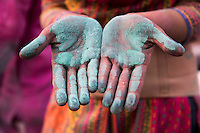 Detail of a woman's hands covered in green powder during the Holi Festival, Barsana, India.