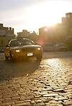 n.y.c. taxi cab old cobblestone street ny nyc sunset