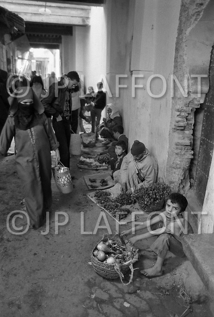 Children street vendors in Fez, Morocco - Child labor as seen around the world between 1979 and 1980 – Photographer Jean Pierre Laffont, touched by the suffering of child workers, chronicled their plight in 12 countries over the course of one year.  Laffont was awarded The World Press Award and Madeline Ross Award among many others for his work.