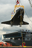 The space shuttle Enterprise is lifted off of a barge and onto the Intrepid Sea, Air and Space Museum where it will be on permanent displayed, Wednesday, June 6, 2012 in New York. .Mandatory Credit: Bill Ingalls / NASA via CNP