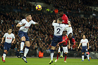 Paul Pogba of Manchester United gets in a header from a corner watched by Kieran Trippier and Toby Alderweireld of Tottenham Hotspur during Tottenham Hotspur vs Manchester United, Premier League Football at Wembley Stadium on 13th January 2019